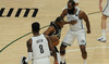 Khris Middleton drives between James Harden (13) and forward Jeff Green (8) during Game 6 of the Bucks-Nets semifinal round playoffs on Thursday. (Michael McLoone-USA TODAY Sports)