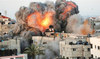 A ball of fire erupts from a building in Gaza City's Rimal residential district on May 16 during massive Israeli bombardment on the Hamas-controlled enclave. (AFP)