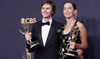 """Evan Peters, left, and Julianne Nicholson pose for a photo with the awards for outstanding supporting actor and actress in a limited or anthology series or movie for """"Mare of Easttown"""" on Sunday, Sept. 19, 2021 in Los Angeles. (AP)"""